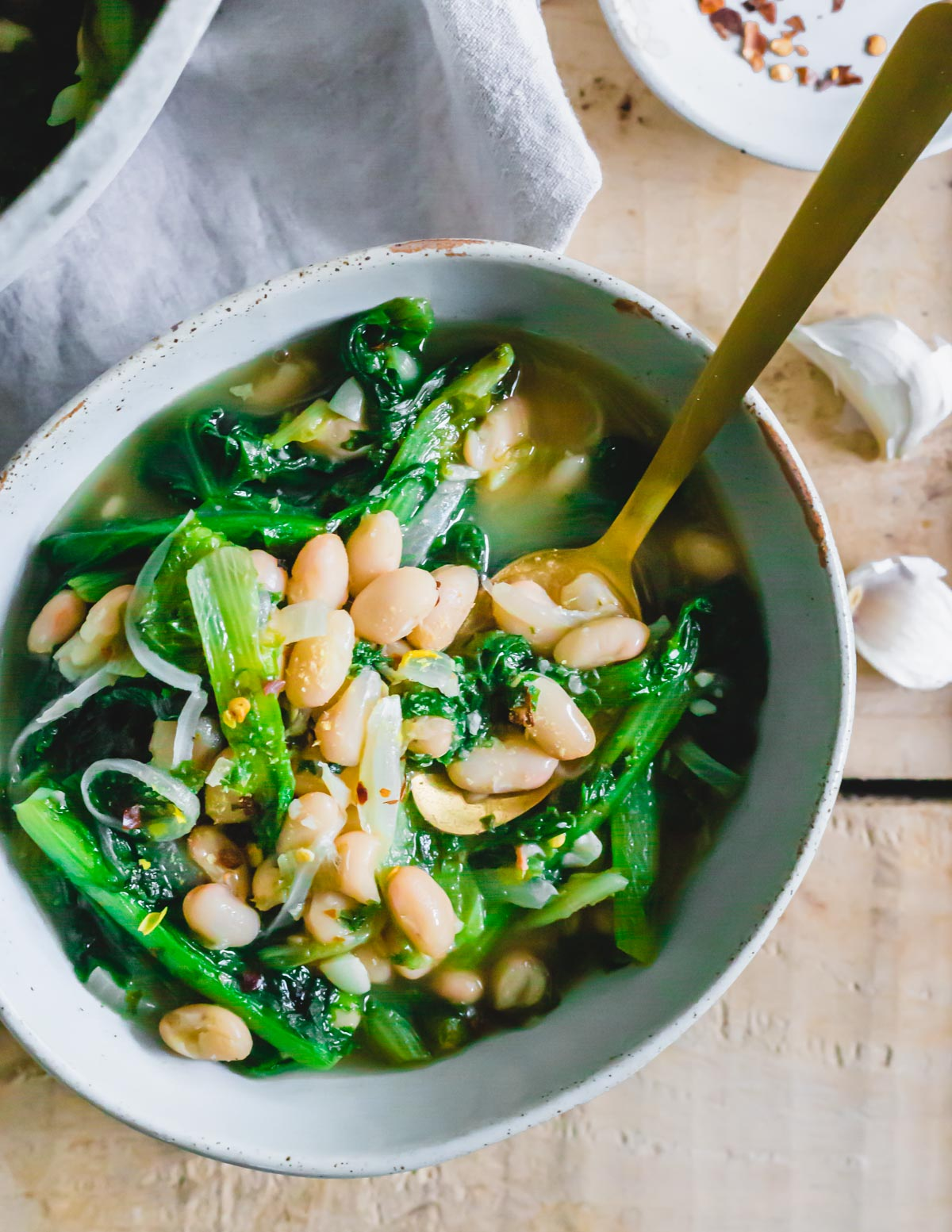 Recipe for escarole and cannellini beans in a bowl.