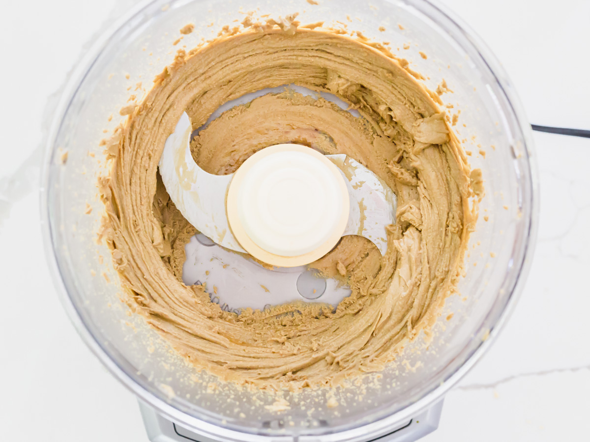 Spreadable pumpkin seed butter after processing for 6 minutes.